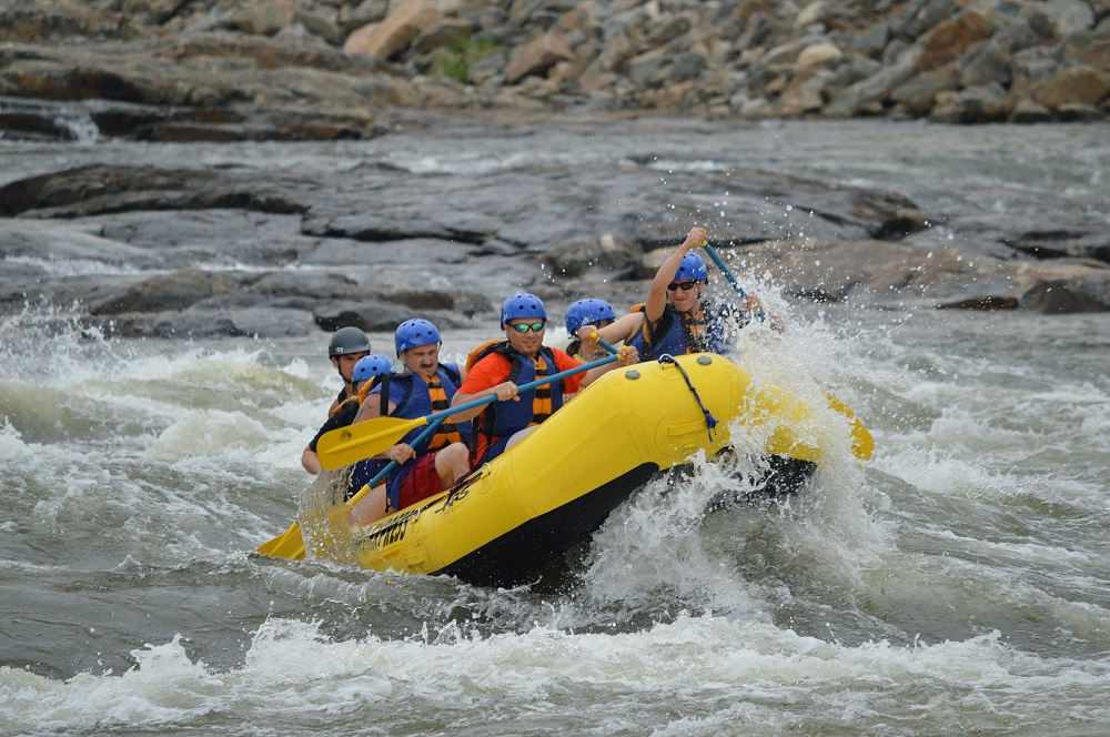 A group of people whitewater rafting in Utah.